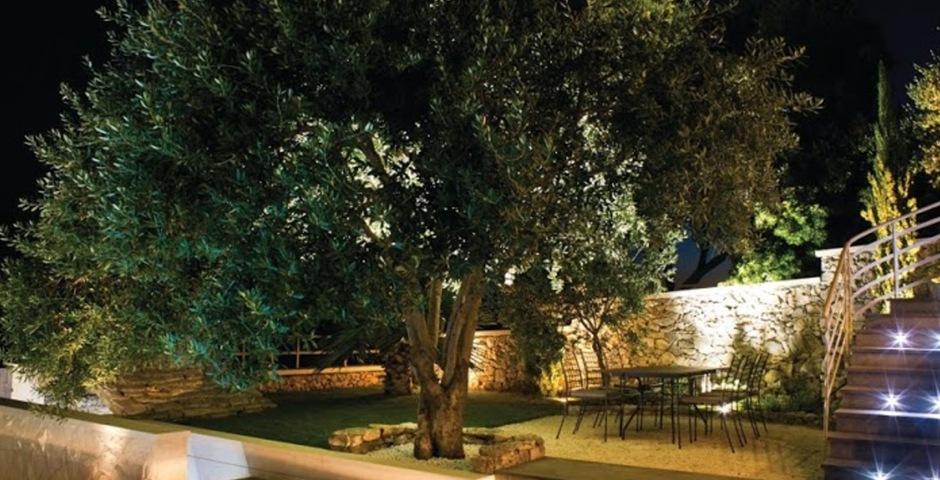 Show luxury villa trogir croatia outside dining area by night