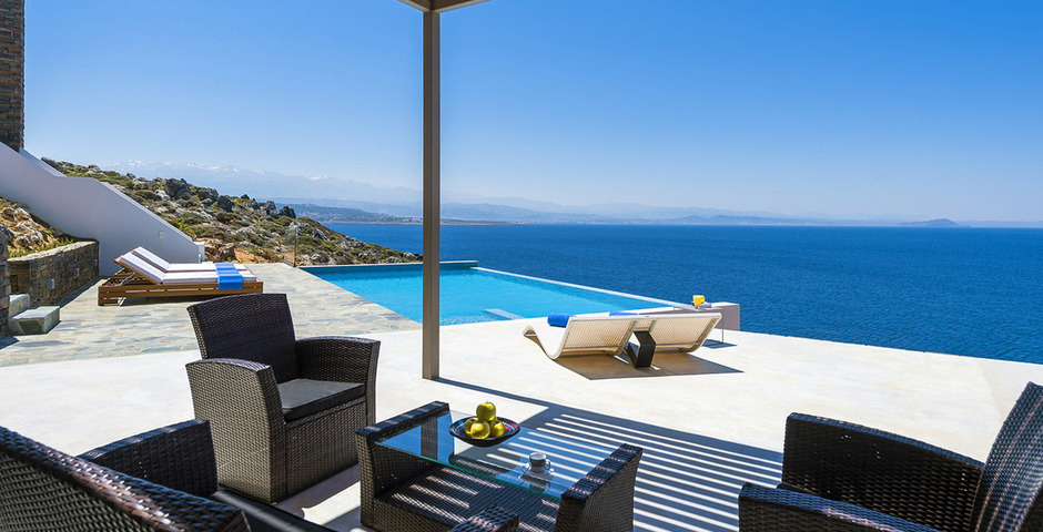 Show luxury villa crete seafront outdoor dining 1
