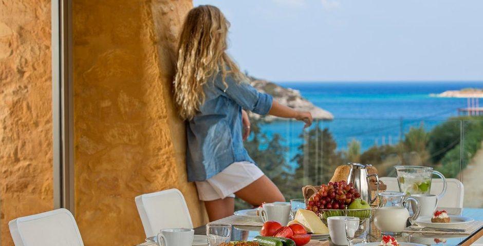 Show luxury stone villa akrotiri crete greece outdoor dinig