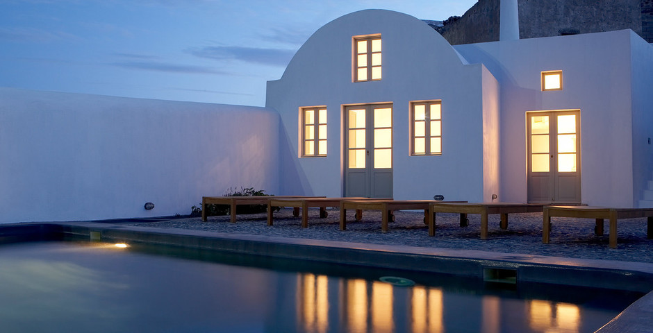 Show luxury villa santorini greece old factory loft style leisure pool public dining dusk