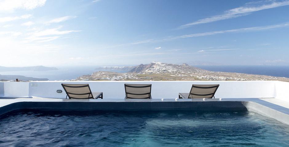 Show luxury villa santorini greece old factory loft style roof terrace outdoor jacuzzi