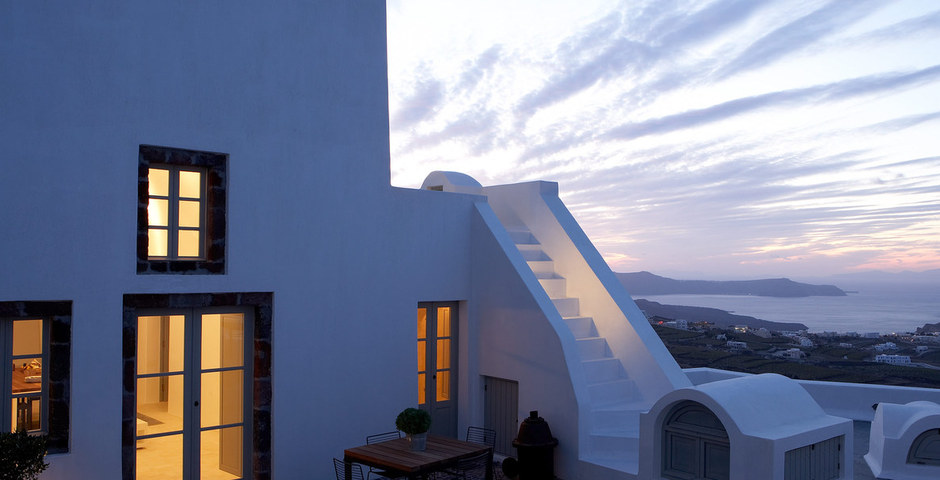 Show luxury villa santorini greece old factory loft style upper courtyarg at dusk