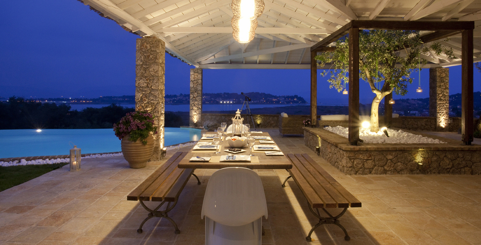 Show luxury seafront villa corfu piedra outdoor dining area by night