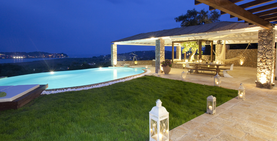 Show luxury seafront villa corfu piedra swimming pool area by night